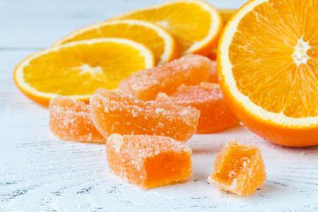 Orange marmelad with slided oranges on table