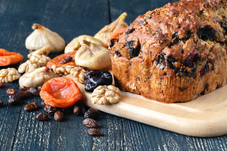 Traditional stollen fruit cake sliced on table