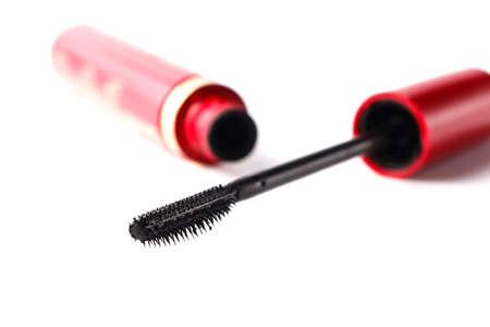 Closeup Mascara Bottle and Brush. Black Mascara wand and Tube Isolated on White