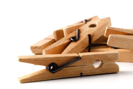 Wooden clothes pegs for clothes drying Stock Photo