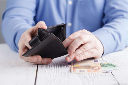 people, business, finances and money concept - close up of businessman hands holding open wallet with euro cash Stockfoto