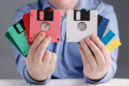 Male hold floppy disk in hands, retro storage Stock Photo