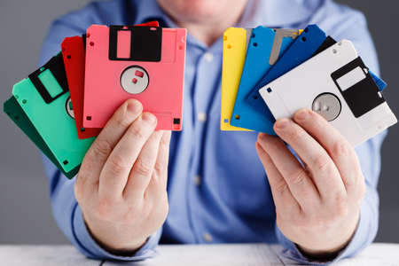 Male hold floppy disk in hands, retro storage Stock fotó
