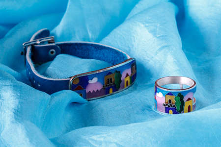 georgia jewelry on blue silk