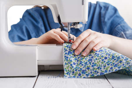 working with needle and thread and sewing machine with a colored thread