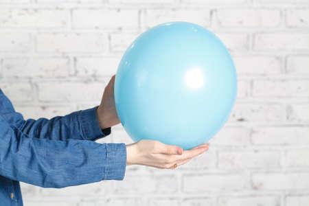 Blue balloon in female hands