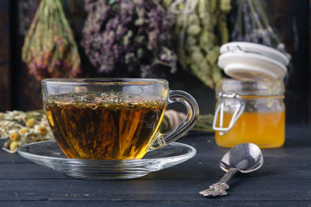 honey and healing herbs for folk medicine, ethnoscience concept Stock Photo