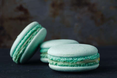 Blue french macaroons on rustic background
