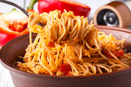 Asian meal made of rice noodles, tofu, vegetables and shiitake mushrooms. Traditional Oriental cuisine meal.
