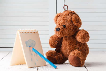 Teddy bear draw rainy weather sign Stock Photo