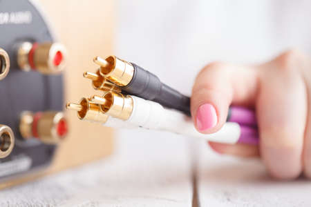 Hi-fi music cable in female hands Stock Photo