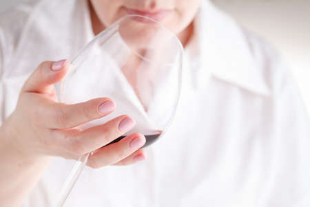 Female tasting red wine