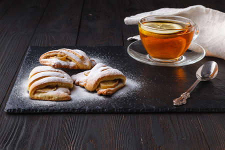 Continental breakfast with pastry and cup of tea Imagens