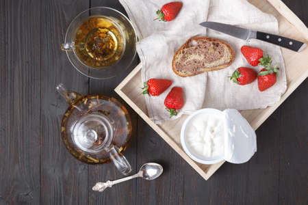 toast with curd cream and fresh strawberries. The concept of a useful dessert 写真素材