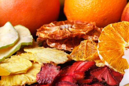 Dried fruit with juicy slices of citrus. Orange, lemon, grapefruit. Citrus mix concept. Healthy snack