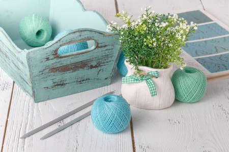 Needlework female hobby concept, ball of yarn on table Фото со стока