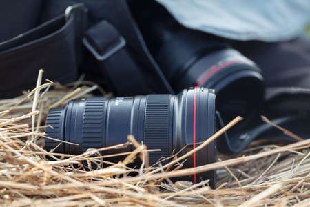 photographic lens is lying on a haystack, countryside protographer concept