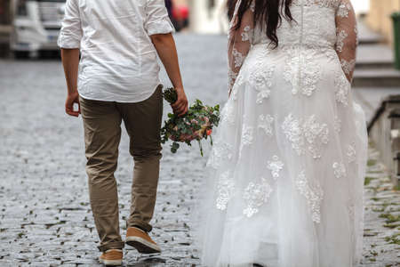Plus size Bride and Groom with the Bridal Bouquet