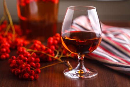 Fall harvest, made alcohol from berries Stock Photo