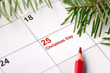 25 date on calendar with Red mark. Save the date. Christmas holiday preparation concept