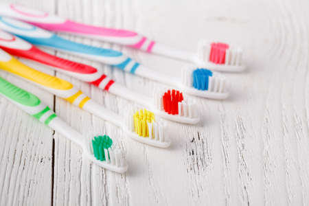Many colorful toothbrushes