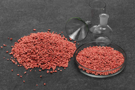 Mineral fertilizer with phosphorus in red with chemical glass