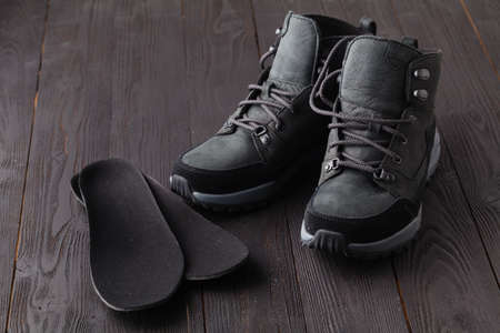 Warm shoes and orthopedic insoles. Winter background, footwear 版權商用圖片