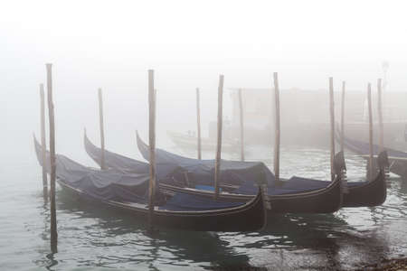 Quay of San Marco and the lagoon in the fog of Venice
