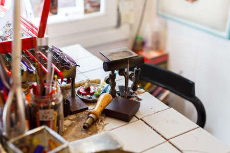 Glass craftsman workplace  in a Murano workshop, Venice Stock Photo