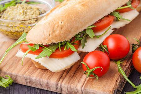 sandwich on a wooden on cutting board