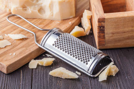 Traditional Italian hard cheese Parmesan and Grana Padano with grater Banco de Imagens
