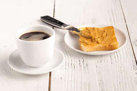 Creamy peanut butter on a slice of toast. Peanut butter sandwich for breakfast