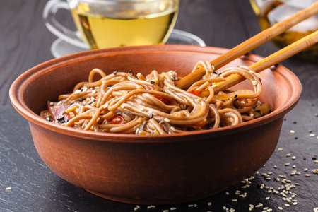 Cold soba buckwheat noodles served and eaten after being dipped in a cold sauce