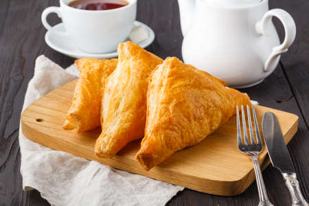 puff pastries triangles in wooden table