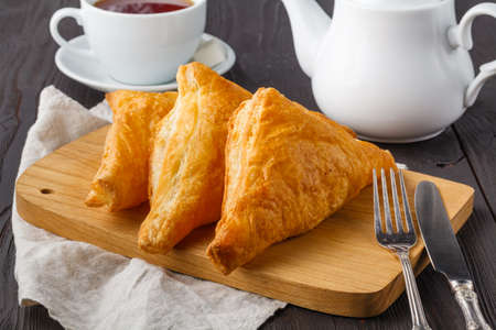 Puff pastry triangles filled with feta cheese and spinach on wooden table Stock fotó - 120598198