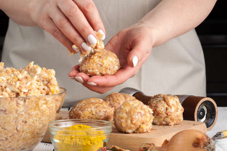 chicken Meatballs with rice, cooking on kitchen
