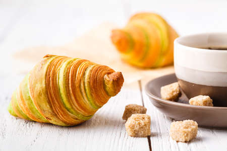 Croissants with chocolate filling cup and fresh morning coffee Stock Photo