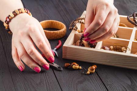 Homemade jewelry. Woman making home craft art bijouterie