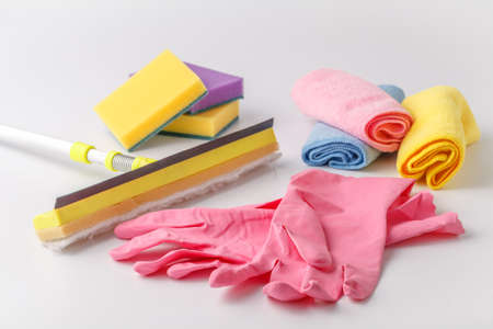 Cleaning set of different items for kitchen, bathroom and other rooms. Copy space. Cleaning service concept