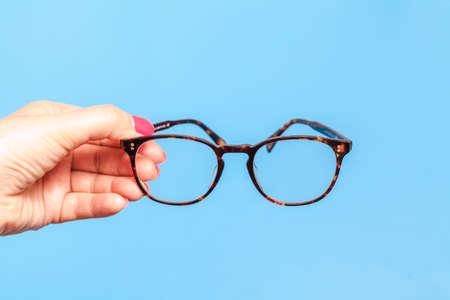 Female hand holding Eye Glasses