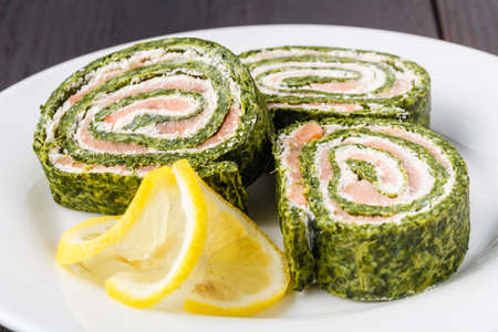 Spinach rolls with smoked salmon and cream cheese Reklamní fotografie