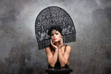 fashion portrait of beautiful woman in big fashion kokoshnik hat.Beauty girls face under hat.studio shot, smoke eyes makeup