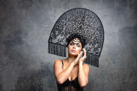 Beautiful woman in Russian kokoshnik hat. Retro fashion Stock Photo