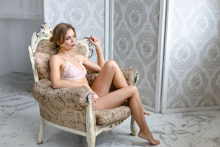 Beautiful sensual woman in laced lingerie Reklamní fotografie - 132115157