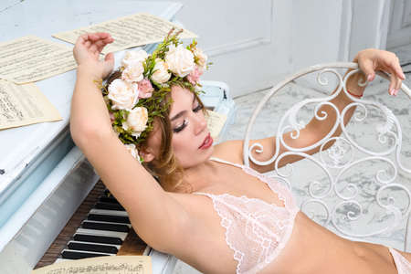 Fashionable photo of young sexy lady wearing white lingerie