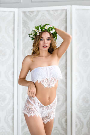 Fashionable photo of young sexy lady wearing white lingerie Banco de Imagens - 132115167