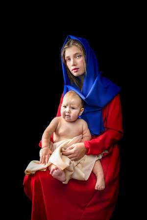 Mother with baby, motherhood concept. in the image of the madonna