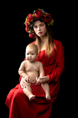 Portrait of loving mother and her baby on hand, mother's day concept