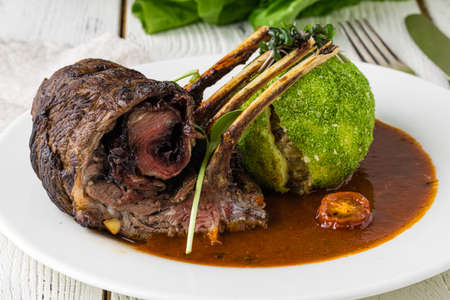 Organic Grilled Lamb Chops with Garlic and Lime on dish