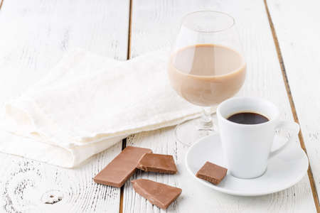 coffee in white ceramic cup and choco